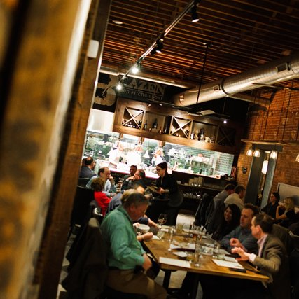 Patrons ordering food and dining at Brazen Open Kitchen and Bar