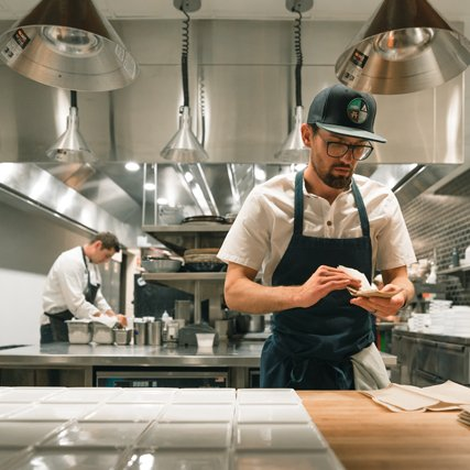 Chef Kevin Scharpf working in the kitchen at Brazen Open Kitchen | Bar